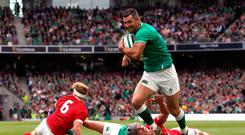 Ireland's Rob Kearney (right) goes passed Wales' Jonathan Davies (second right) on his way to scoring his sides fourth try during the Guinness Summer Series match at the Aviva Stadium, Dublin. PA Photo. Picture date: Saturday September 7, 2019. Brian Lawless/PA Wire.