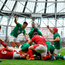 Josh van der Flier, right, and Conor Murray of Ireland celebrate their side's 3rd try scored by James Ryan, hidden, of Ireland during the Guinness Summer Series match between Ireland and Wales at Aviva Stadium in Dublin.Photo by David Fitzgerald/Sportsfile