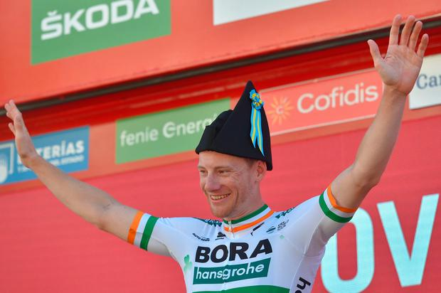 Team Bora rider Ireland's Sam Bennett celebrates on the podium after winning the 14th stage of the 2019 La Vuelta cycling Tour of Spain, a 188 km race from San Vicente de la Barquera to Ovieda on September 7, 2019. (Photo by ANDER GILLENEA / AFP)ANDER GILLENEA/AFP/Getty Images