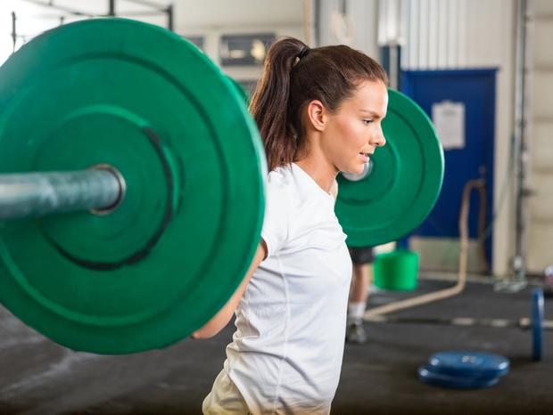 Woman lifting weights. Stock image