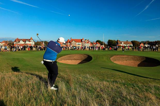 HOYLAKE, ENGLAND - SEPTEMBER 07: Caolan Rafferty of the Great Britain and Ireland team plays his third shot on the 16th hole in his match against Alex Smalley of the United States team during the afternoon singles matches in the 2019 Walker Cup Match at Royal Liverpool Golf Club on September 07, 2019 in Hoylake, England. (Photo by David Cannon/Getty Images)
