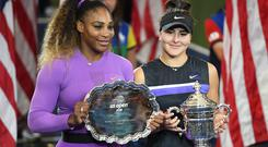 NEW YORK, NEW YORK - SEPTEMBER 07: Bianca Andreescu of Canada celebrates with the championship trophy alongside runner up Serena Williams. (Photo by Emilee Chinn/Getty Images)