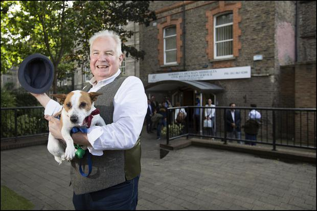 NUPTIALS: Campbell Spray with his dog outside the Dublin Registry Office where this week he will be married for the third time. PHOTO: David Conachy