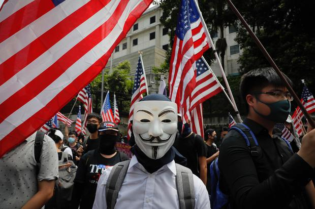 A protester wears a mask often associated with the hacker group Anonymous during a protest in Hong Kong, Sunday, Sept. 8, 2019. Demonstrators in Hong Kong plan to march to the U.S. Consulate on Sunday to drum up international support for their protest movement, a day after attempts to disrupt transportation to the airport were thwarted by police. (AP Photo/Kin Cheung)