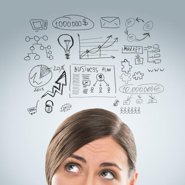 Young business woman thinking of her plans. Stock image