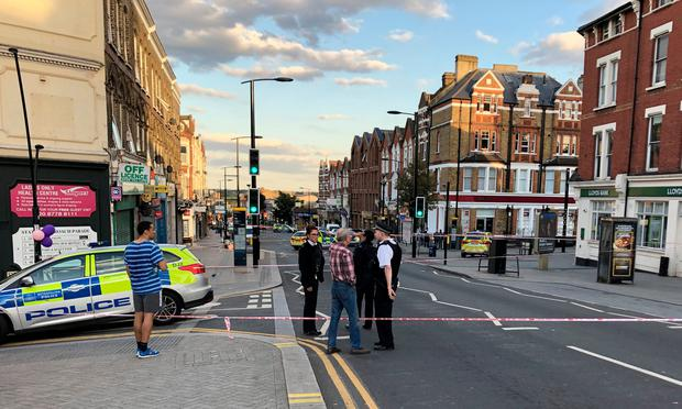 A police cordon in Sydenham Road, south-east London, after a man in his twenties was found with gunshot wounds and died at the scene on Sunday afternoon. PA Photo. Photo: Tess De La Mare/PA Wire