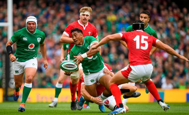 Bundee Aki offloads in the tackle during Saturday's final World Cup warm-up against Wales. Photo: Ramsey Cardy/Sportsfile