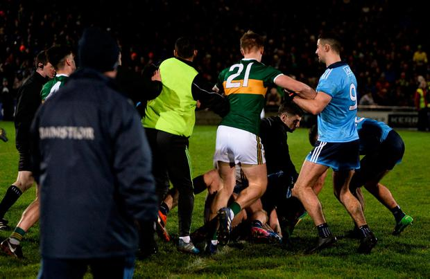 Dublin manager Jim Gavin (foreground, left) walks close to a melee at the end of the National League game against Kerry in Tralee last February. Photo: Diarmuid Greene/Sportsfile