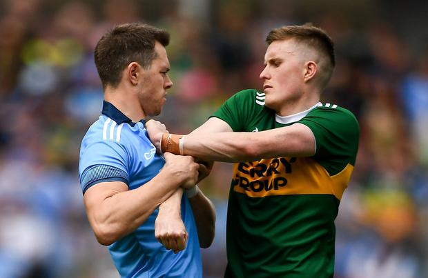 NICE TO MEET YOU: Dublin's Dean Rock and Kerry's Jason Foley tussle during the All-Ireland SFC final over a week ago. Photo: David Fitzgerald/Sportsfile
