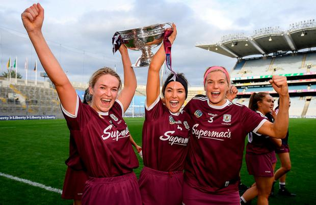 2019; Lorraine Ryan, left, Heather Cooney, centre, Sarah Dervan of Galway with the O'Duffy Cup following their All-Ireland final victory over Kilkenny at Croke Park. Photo: Ramsey Cardy/Sportsfile