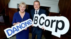 Business Minister Heather Humphreys with the head of Danone Dairy Ireland, James Bruce. Photo: Maxwells