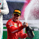 TOPSHOT - Winner Ferrari's Monegasque driver Charles Leclerc (C) celebrates with champagne next to second placed Mercedes' Finnish driver Valtteri Bottas (L) and third placed Mercedes' British driver Lewis Hamilton (R) on the podium after the Italian Formula One Grand Prix at the Autodromo Nazionale circuit in Monza on September 8, 2019. (Photo by Miguel MEDINA / AFP)MIGUEL MEDINA/AFP/Getty Images