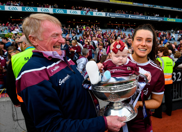 Rebecca Hennelly of Galway with her father Gerry and niece Anna O'Reilly in the O'Duffy Cup. Picture: Sportsfile