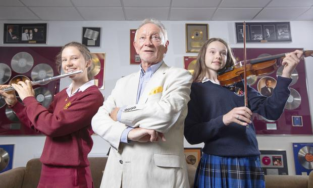 Sweet music: Musician Phil Coulter with Rachel Lynch (18) of Loreto College, St Stephen's Green, Dublin, and Sarah Ambrose (16) of St Raphaela's Secondary School, Stillorgan, at the launch of the 2019 Top Security Frank Maher Classical Music Awards. PHOTO: PETER HOULIHAN