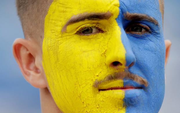 A Kosovo fan inside the stadium before the game. Photo: Reuters/Florion Goga