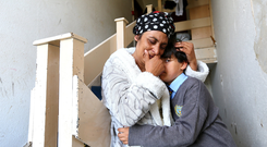 Devastated: Linonice Serban, from Romania, and son Ionut (9), at their flat in Seville Place. Photo: David Conachy