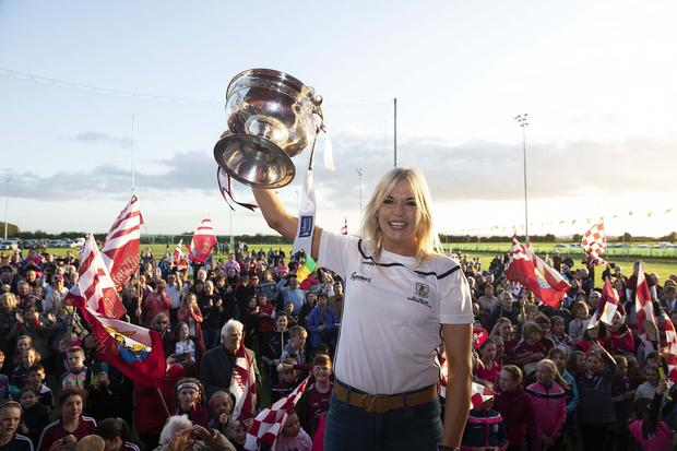 Joy: Sarah Dervan raises the O'Duffy Cup at the homecoming in her native village of Mullagh. Photo: Andrew Downes, Xposure