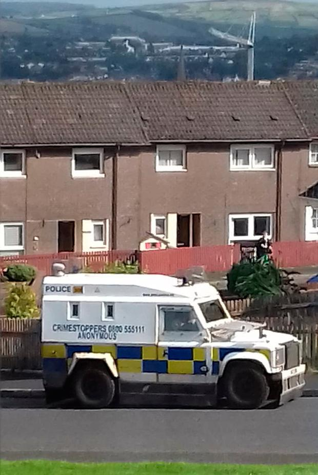 Police at the scene in Creggan Heights, Derry, after residents were evacuated when a suspicious device was found in a house. Aoife Moore/PA Wire