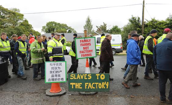 Garda keep a close eye on the farmers protest outside Liffey Meats in Ballyjamesduff, Co. Cavan last week. Photo: Lorraine Teevan