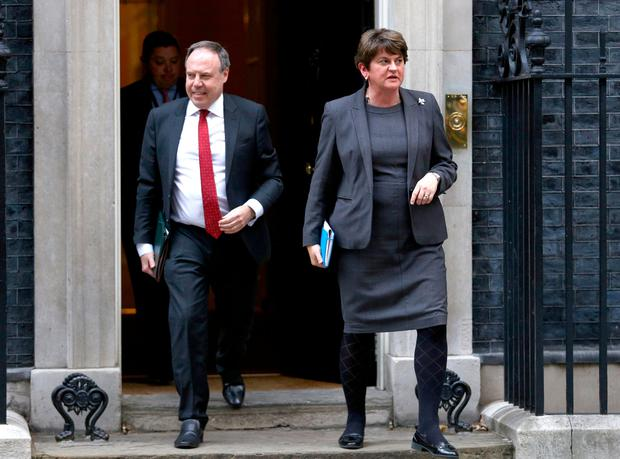 DUP Leader Arlene Foster and deputy leader Nigel Dodds exit 10 Downing Street, London following a meeting with Prime Minister Boris Johnson. Photo: Aaron Chown/PA Wire