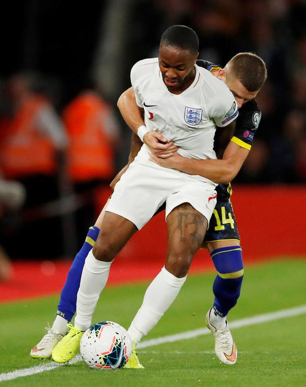 England's Raheem Sterling in action with Kosovo's Valon Berisha. Photo: Action Images via Reuters/Andrew Boyers