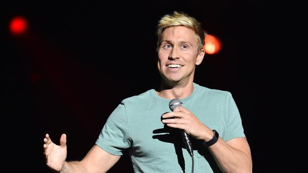 Russell Howard performing on stage at the Royal Albert Hall (PA)