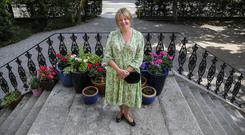 In contact with nature: Susie Aherne-Grey on the steps of her home