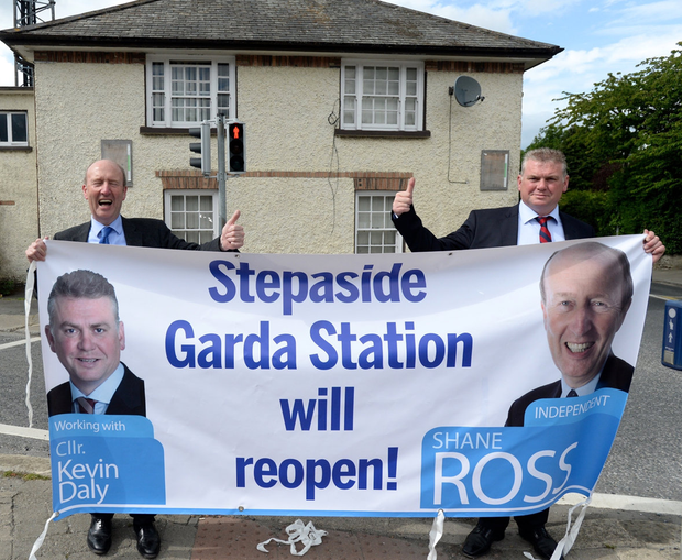 Pilot scheme: Minister Shane Ross and former Councillor Kevin Daly outside the Garda station. Photo: Justin Farrelly