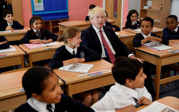 Learning a lesson: Britain's Prime Minister Boris Johnson attends a history class with pupils during a visit to Pimlico Primary school in London. Photo: REUTERS/Toby Melville