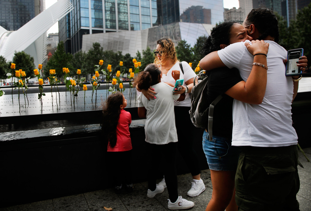 Tears: The children of Flowers Elena Ledesma, a victim of the 9/11 attacks in 2001 which killed 2,997 people, at the September 11 Memorial. Photo: Getty Images