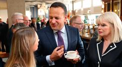 Taoiseach Leo Varadkar chats with general election candidate Emer Currie (left) and TD Mary Mitchell O'Connor (right) during the Fine Gael parliamentary meeting at the Garryvoe Hotel in Cork. Photo: Niall Carson/PA Wire