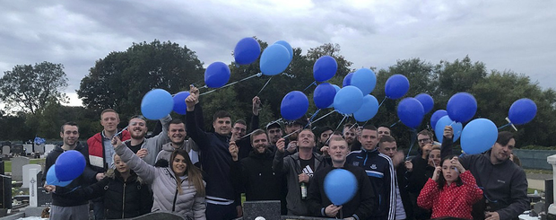 Shane Rock's friends releasing balloons at his graveside on his 27th birthday