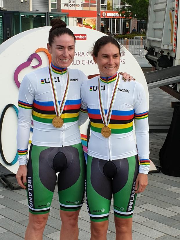 Katie-George Dunlevy (right) and Eve McCrystal celebrate their gold medals at the UCI Paracycling World Championships. Image credit: Cycling Ireland.
