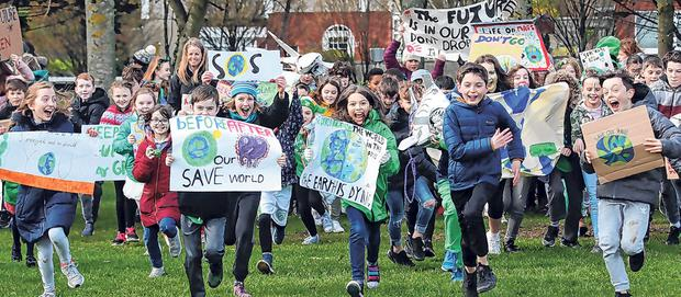 Action: Children from Glasnevin Educate Together National School during a march earlier this year to raise awareness of Climate Change. Photo: Colin Keegan/Collins
