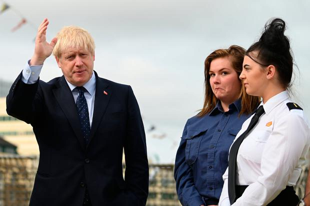 Denied lying to queen: UK Prime Minister Boris Johnson speaks to apprentices yesterday as he visited the NLV Pharos, a lighthouse tender moored on the River Thames to mark London International Shipping Week. Photo: Daniel Leal-Olivas/PA Wire