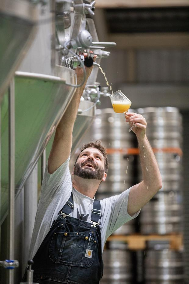 Sample: Bill Laukitis, head brewer at Rye River Brewing Company in action in the brewery