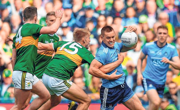 Geting to grips with King Con: Con O'Callaghan of Dublin is tackled by Kerry pair Tom O'Sullivan (left) and Killian Spillane in the drawn game. Photo: Sportsfile