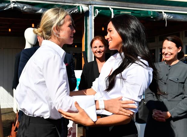 The Duchess of Sussex (right) hugs designer Misha Nonoo at the launch the Smart Works capsule collection at John Lewis in Oxford Street, London Photo credit: Mark Large/Daily Mail/PA Wire
