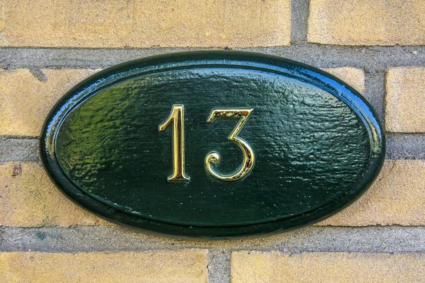 Research shows that buying house number 13 is almost €5,000 cheaper than homes with other door numbers. Stock Image