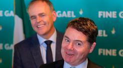 All smiles: Education Minister Joe McHugh and Finance Minister Paschal Donohoe see the funny side at the Fine Gael 'think-in' in Garryvoe. Photo: Niall Carson/PA Wire