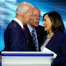 Former Vice President Joe Biden, Senator Bernie Sanders and Senator Kamala Harris talk after the conclusion of the 2020 Democratic U.S. presidential debate in Houston, Texas, U.S., September 12, 2019. REUTERS/Mike Blake