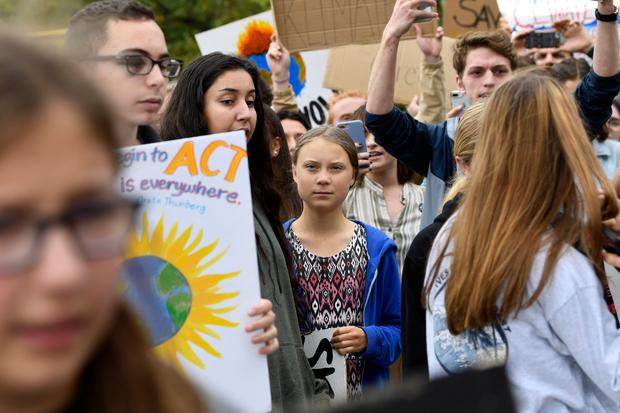 Greta Thunberg, center, marches with other young climate activists for a climate strike outside the White House in Washington (AP Photo/Susan Walsh)