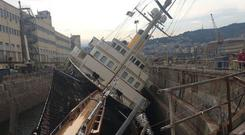 Listing: The Nero, owned by Denis O'Brien, rests on one side in dry dock in Genoa