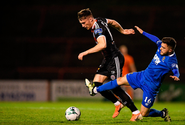 Danny Grant of Bohemians is tackled by Cory Galvin of Waterford. Photo by Eóin Noonan/Sportsfile