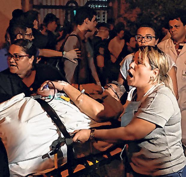Patients are evacuated from the Rio hospital. Photo: AP
