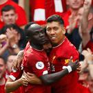 Liverpool's Sadio Mane celebrates scoring their second goal with teammate Roberto Firmino Action Images via Reuters/Jason Cairnduff