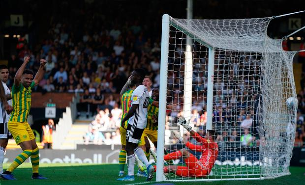 West Bromwich Albion's Semi Ajayi scores his side's first goal during the Sky Bet Championship match at Craven Cottage, London. Photo credit: Tess Derry/PA Wire.