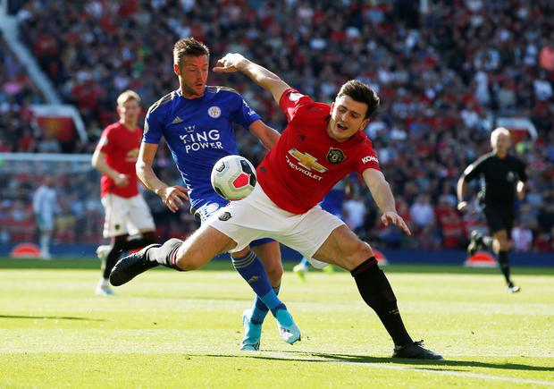 Manchester United's Harry Maguire in action with Leicester City's Jamie Vardy during the Premier League clash at Old Trafford. Photo: Reuters/Andrew Yates