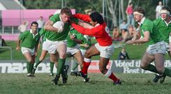 Irish rugbyman Terry Kingston (with the ball) fending off Tonga's Liueli Fusimalohi during the 1987 Rugby World Cup. Photo: AFP/Getty Images