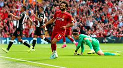 Mohamed Salah celebrates after scoring Liverpool's third goal in the win over Newcastle at Anfield yesterday. Photo: Nigel French